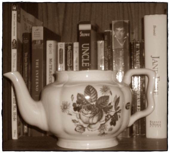 My grandma's teapot on my bookshelf.  I would show the whole shelf but it is currently uglified and needs some TLC.