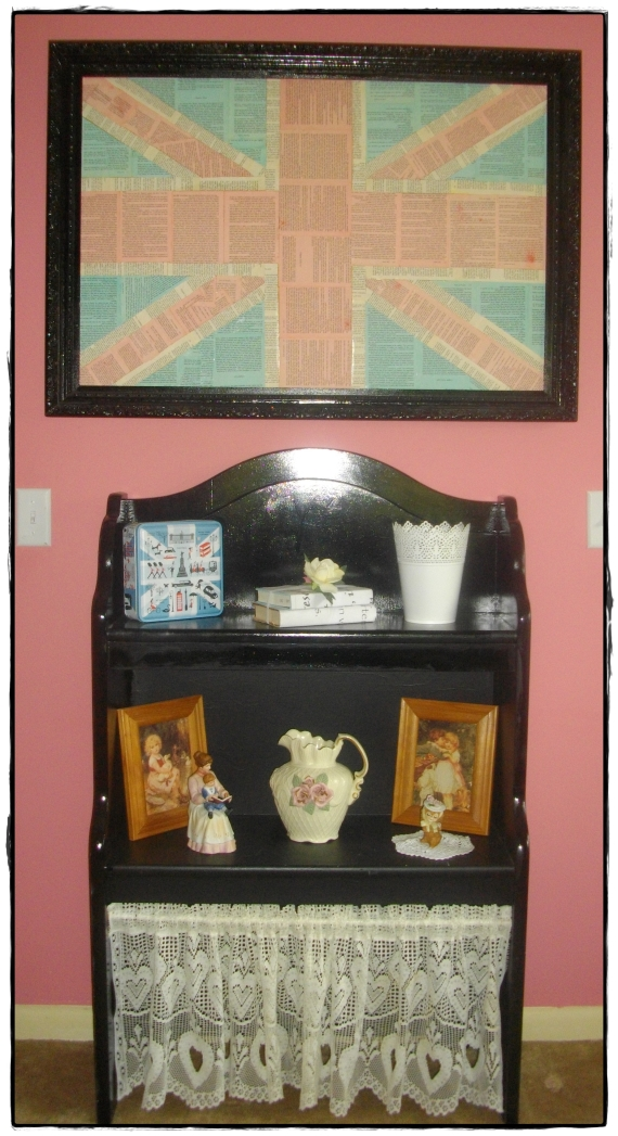 I love this wall in my room.  The shelf is actually a hutch that was above my son's desk with a valance on the bottom.  The Union Jack is made of Pride and Prejudice pages that are dyed and set in my grandma's antique frame.