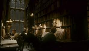 The single most amazing library has to be in the Harry Potter films.  I mean the books put themselves away.
