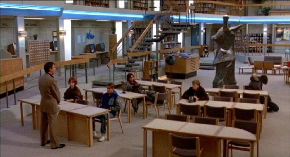 The coolest cinematic library award goes to The Breakfast Club.  I hung out in the library all the time, nothing cool ever happened.