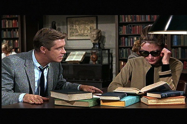Breakfast at Tiffany's gets the award for most romantic library scene.
